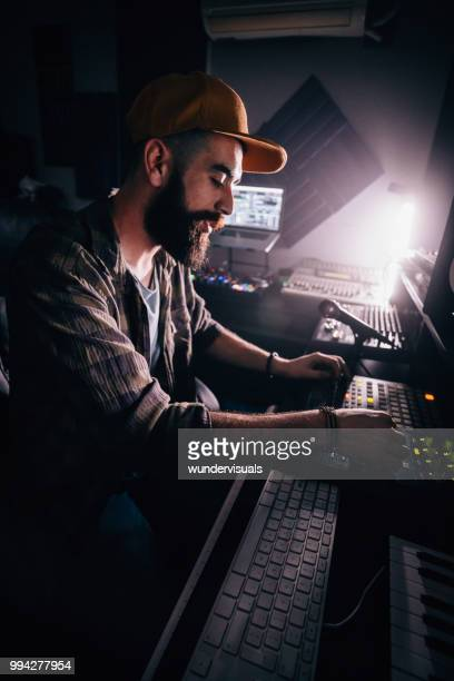 hipster radio station dj and presenter broadcasting music from studio - post-production stock pictures, royalty-free photos & images