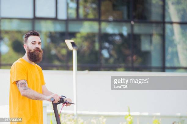 young bearded man yellow tshirt an