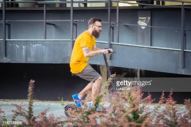 handsome bearded man yellow tshirt riding