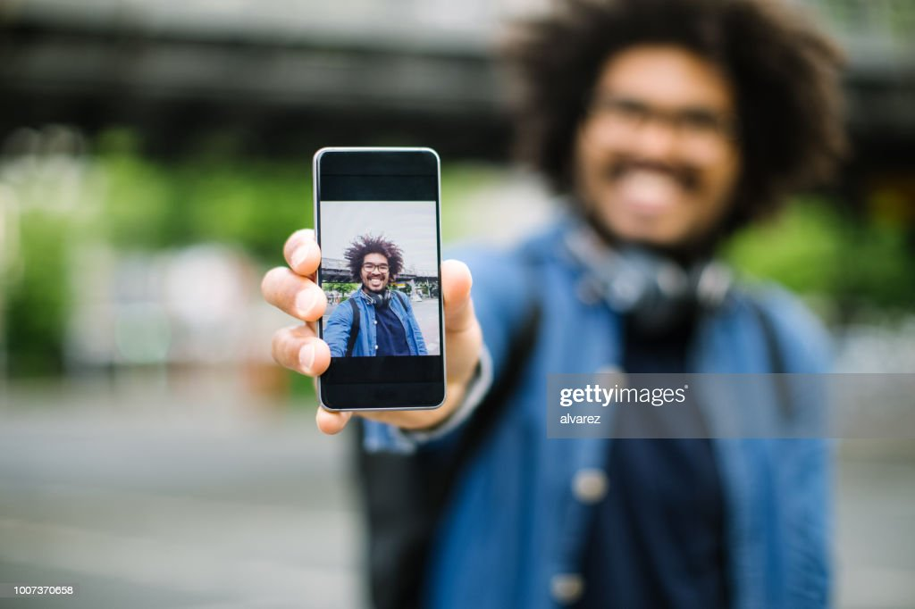 Hipster showing his selfie : Stock Photo