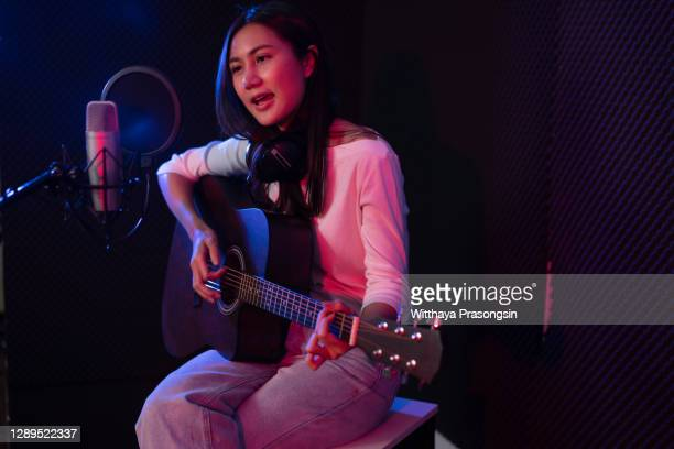 hipster singer and music producer recording songs in music studio - rapper stock pictures, royalty-free photos & images