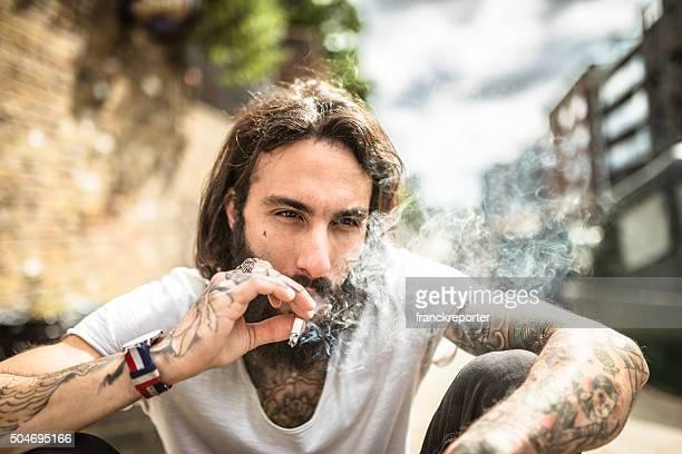 Hipster smoking and thinking sitting sad