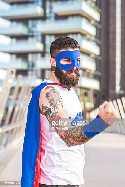 Hipster superhero showing fist