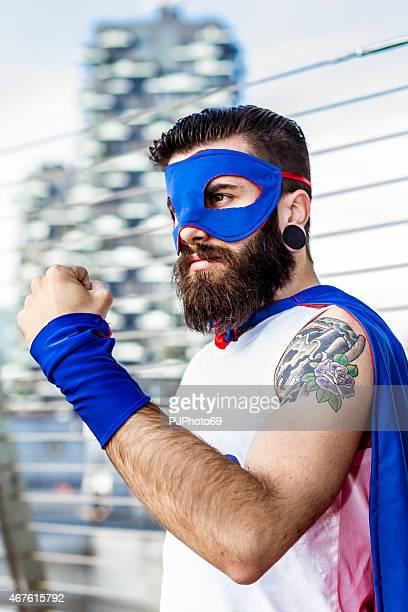 hipster-superheld zeigt faust - pjphoto69 stock-fotos und bilder