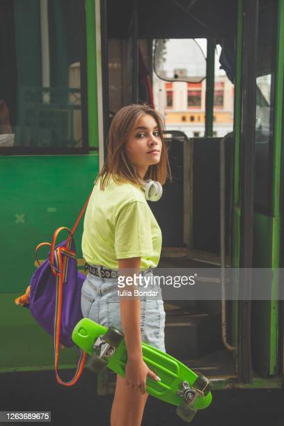 hipster teenage girl going to the public bus - coach purse stock pictures, royalty-free photos & images