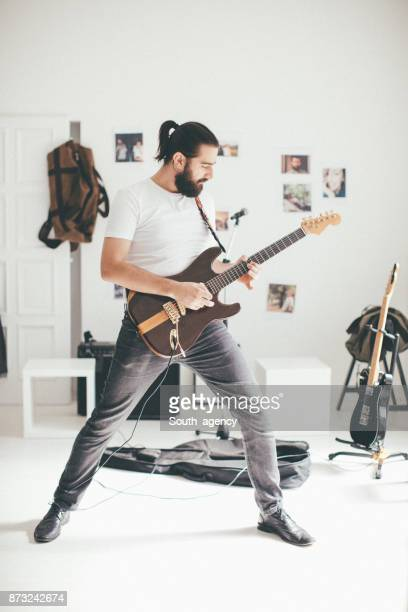 Hipster with a guitar