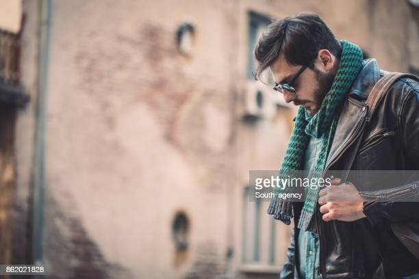 hipster with green scarf - biker jacket stock photos and pictures