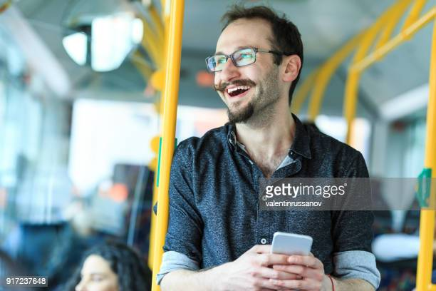 hipster with smart phone inside of a bus - public transport stock pictures, royalty-free photos & images