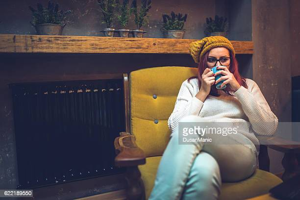 Hipster woman with a Mug in Hands