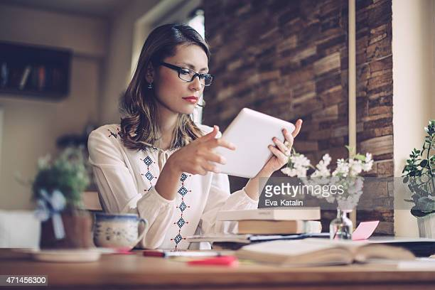Hipster woman working at home