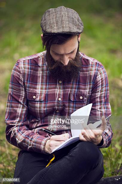hipster writing and reading - poet stock pictures, royalty-free photos & images