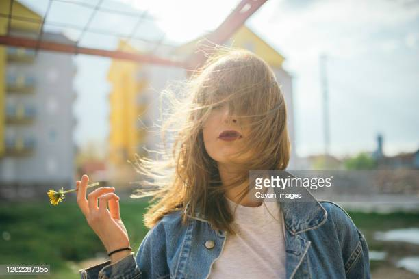 hipster young woman smoking yellow flower. - seulement des adultes photos et images de collection