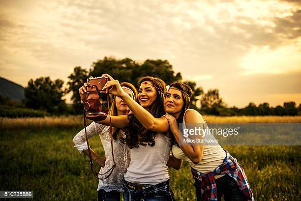Hipsters take a photo in field