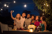 Hipsters Taking a Selfie at a Summer Backyard BBQ
