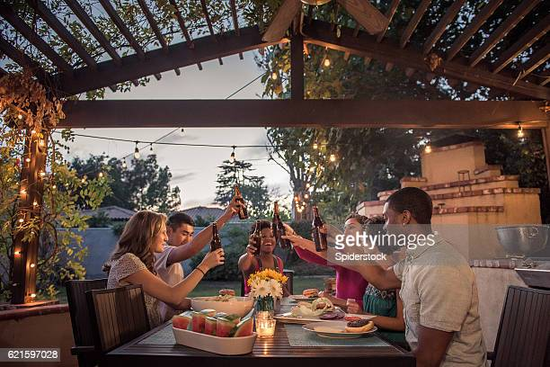 Hipsters Toasting at a Summer Backyard BBQ