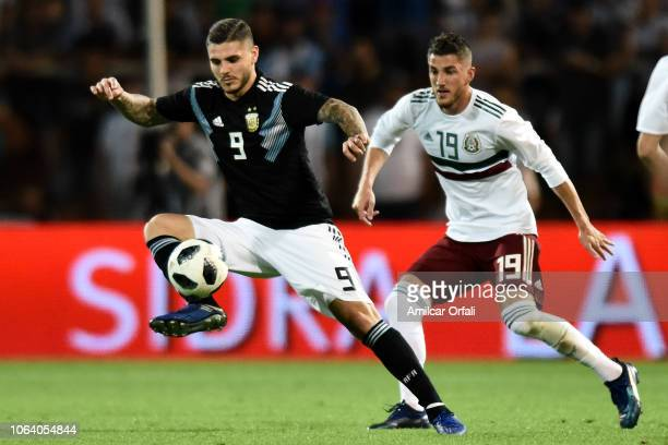 Hiram Mier of Mexico fights for the ball with Mauro Icardi of Argentina during a friendly match between Argentina and Mexico at Malvinas Argentinas...