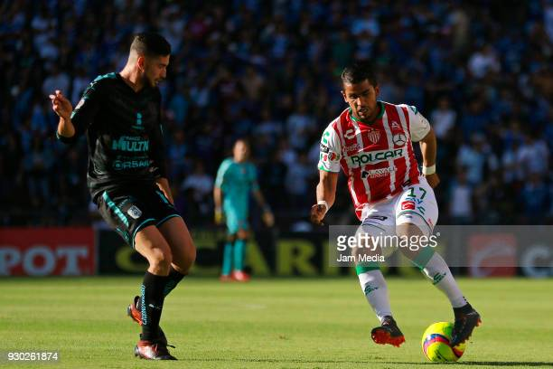 Hiram Mier of Queretaro and Miguel Ponce of Necaxa compete for the ball during the 11th round match between Queretaro and Necaxa as part of the...