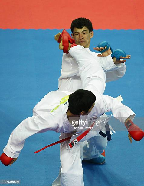 Hirannithishatphol Saratham of Thailand competes against Eldor Djambaev of Uzbekistan in the Men's 55kg first round at Guangdong Gymnasium during day...