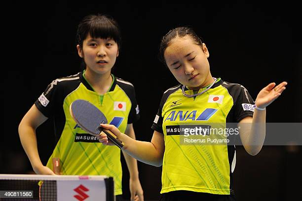 Hirano Miu and Ito Mima of Japan compete against Song Maeum and Yoo Eunchong of South Korea during Women's doubles quarterfinal match of the 22nd...