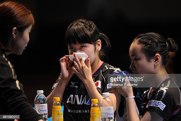 Hirano Miu and Ito Mima of Japan listen to coach as they compete against Jiang Huajun and Tie Yana of Hong Kong during Women's doubles semifinal...
