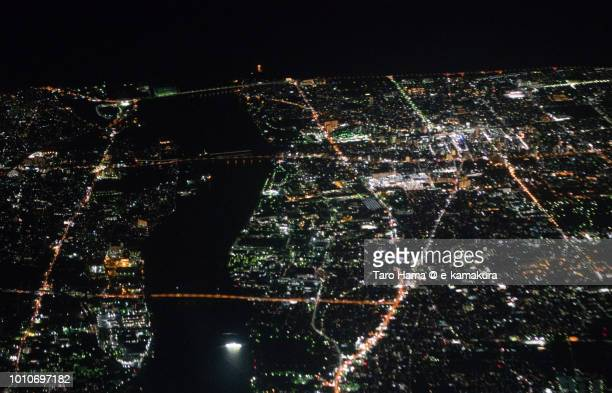 Hiratsuka and Chigasaki cities in Kanagawa prefecture in Japan night time aerial view from airplane