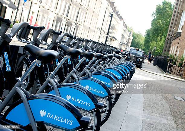 hire bikes - barclays brand name stock photos and pictures