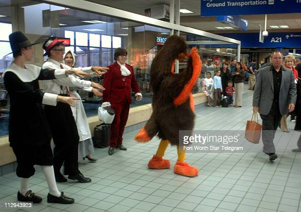 Hired entertainers from pilgrims to a turkey to Austin Powers engage travelers in the secure area of Terminal A at DFW Airport on Wednesday November...