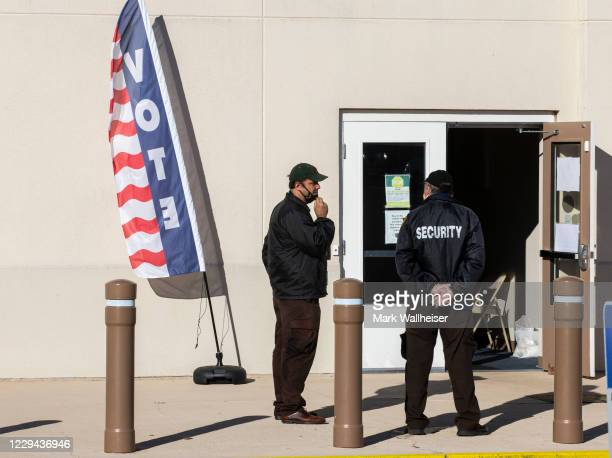 Hired security personnel wait for voters outside the Leon County Supervisor of Elections office on November 3, 2020 in Tallahassee, Florida. After a...