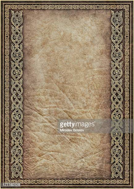 hi-res antique parchment with medieval gilded arabesque linear decorative motif - byzantine stock pictures, royalty-free photos & images