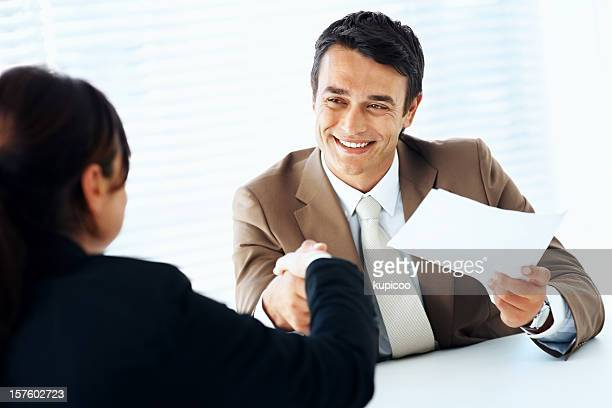 Hiring - Friendly business man shaking an employee's hand