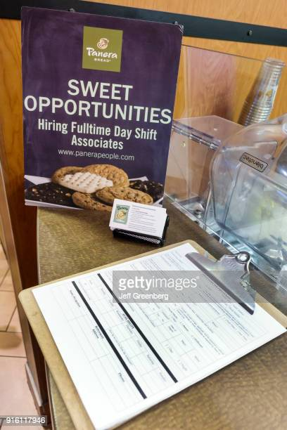 Hiring fulltime day shift associates job application on the counter at Panera Bread