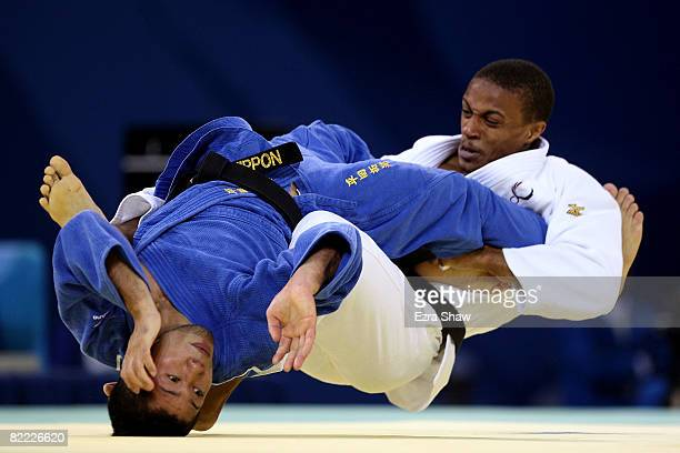Hiroaki Hiraoka of Japan competes against Taraje WilliamsMurray of the United States during their 60 kg preliminary judo bout at the Beijing Science...