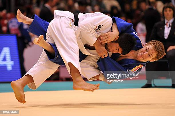 Hiroaki Hiraoka of Japan throws Tobias Engmaier of Germany during the Men's 60kg third round match during day one of the Judo Grand Slam Tokyo at...