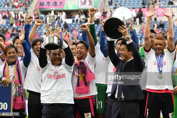 Hiroaki Morishima and head coach Yoon Jong Hwan of Cerezo Osaka celebrate with trophies after the JLeague Levain Cup final match between Cerezo Osaka...