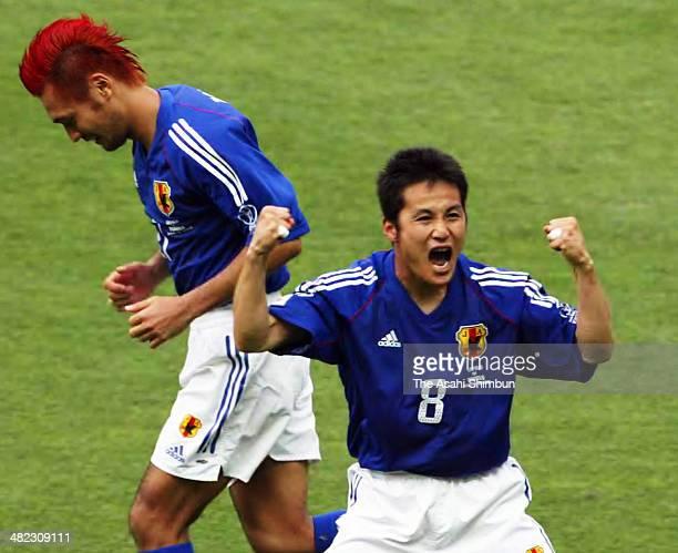 Hiroaki Morishima of Japan celebrates scoring his team's first goal during the FIFA World Cup Korea/Japan Group H match between Japan and Tunisia at...