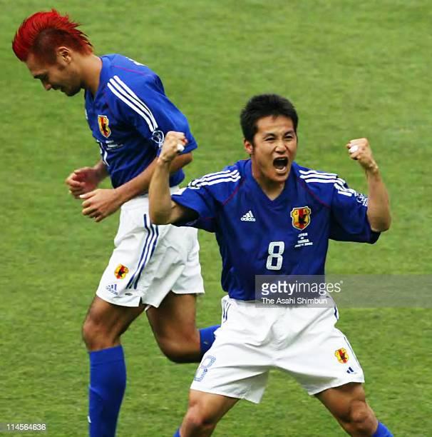 Hiroaki Morishima of Japan celebrates the first goal during the 2002 FIFA World Cup Korea Japan Group H match between Japan and Tunisia at Nagai...