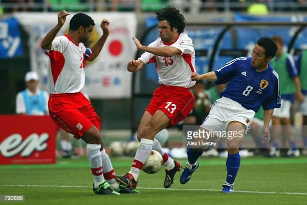 Hiroaki Morishima of Japan tries to tackle Riadh Bouazizi of Tunisia during the FIFA World Cup Finals 2002 Group H match played at the OsakaNagai...