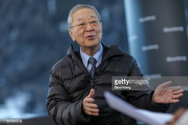 Hiroaki Nakanishi chairman of Hitachi Ltd gestures as he speaks during a Bloomberg Television interview on the opening day of the World Economic...