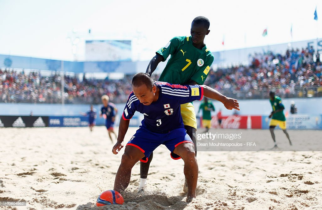 Hirofumi Oda of Japan battles for the ball with Babacar Fall of Senegal during the Group A FIFA Beach Soccer World Cup match between Japan and Senegal held at Espinho Stadium on July 13, 2015 in Espinho, Portugal.
