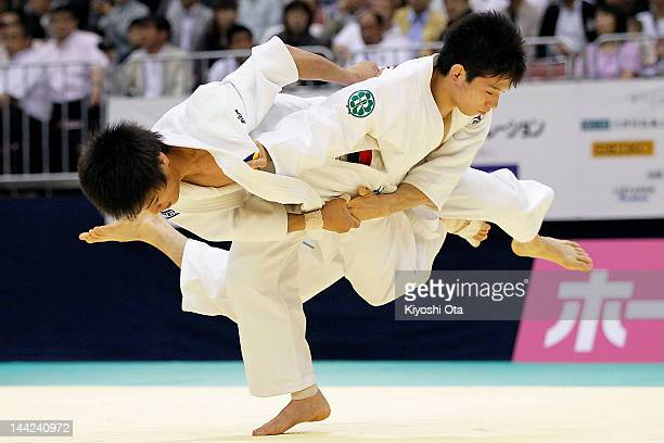 Hirofumi Yamamoto throws Hironori Ishikawa in the Men's 60kg match during day one of the All Japan Judo Weight Class Championships 2012 at Fukuoka...