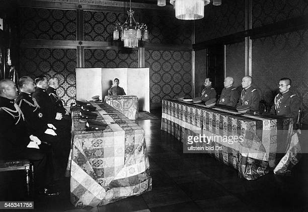 Hirohito Emperor of Japan during a conference of the Council of War to the right Generals of the Imperial Japanese Army and Imperial Japanese Army...