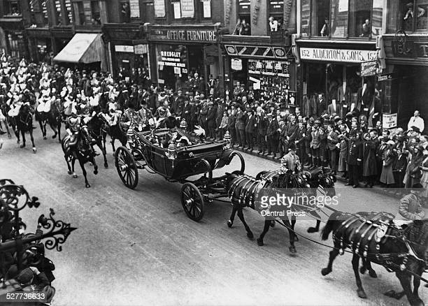 Hirohito, the Crown Prince of Japan drives down Fleet Street in London with the Prince of Wales, later King Edward VIII, during his six-month...