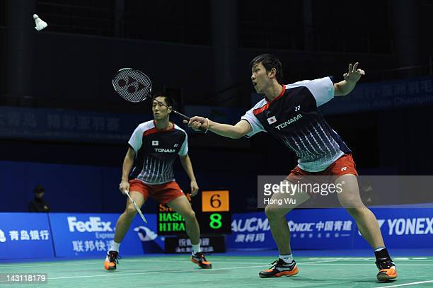 Hirokatsu Hashimoto and Noriyasu Hirata of Japan play a shot during their match against Angga Pratama and Ryan Agung Saputra of Indonesia during day...