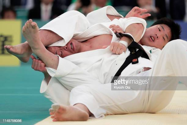 Hirokazu Kageno competes against Kokoro Kageura in the second round match during the All Japan Judo Championship at Nippon Budokan on April 29 2019...