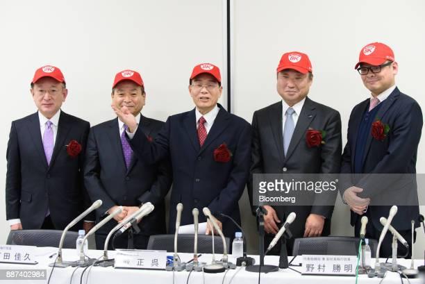Hirokazu Nishiyama executive officer of Sharp Corp from left Yoshihisa Ishida executive vice president Tai Jeng Wu president and chief executive...