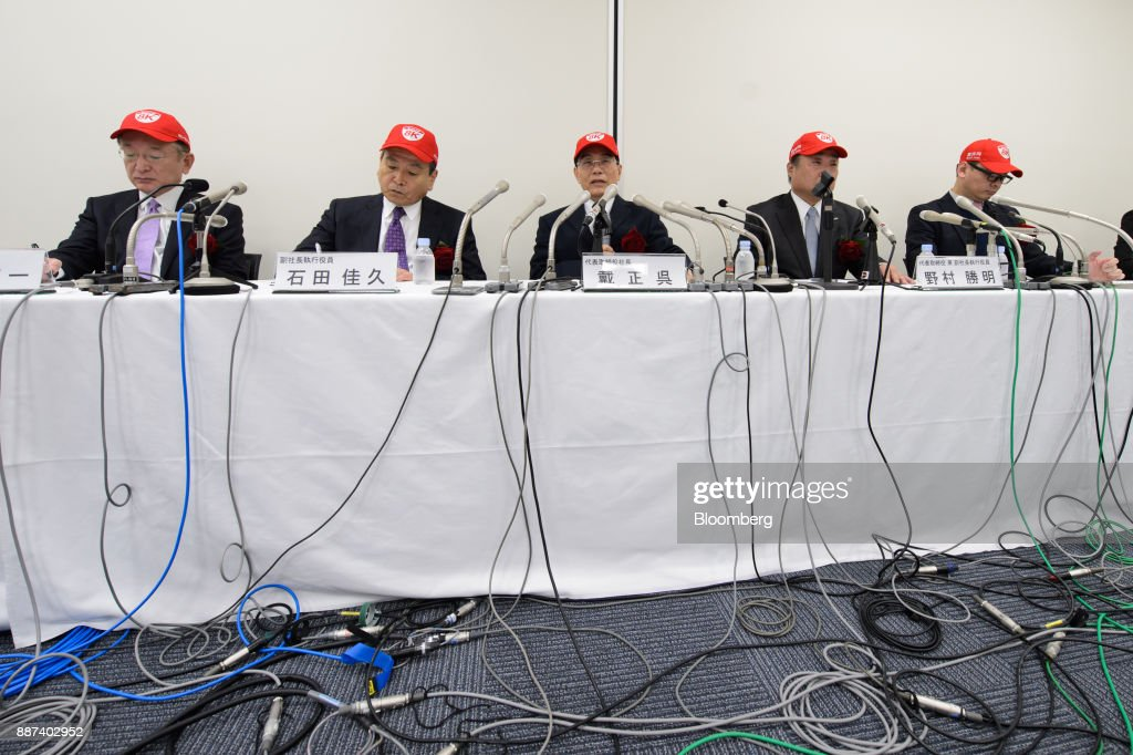Hirokazu Nishiyama, executive officer of Sharp Corp., from let, Yoshihisa Ishida, executive vice president, Tai Jeng Wu, president and chief executive officer, Katsuaki Nomura, executive vice president, Toshiaki Takayama, executive officer, attend a news conference in Tokyo, Japan, on Thursday, Dec. 7, 2017. Taisaid hell remain in the job while seeking a successor in the future, backing away from a promise to step down after returning the company to the Tokyo Stock Exchanges First Section. Sharp was acquired byFoxconn Technology Groupin August 2016 and Tai was sent by the Taiwanese manufacturer to oversee the Japanese electronics makers turnaround. Photographer: Akio Kon/Bloomberg via Getty Images