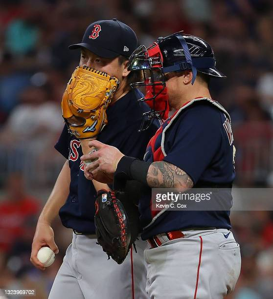 Hirokazu Sawamura of the Boston Red Sox converses with Christian Vazquez in the sixth inning against the Atlanta Braves at Truist Park on June 16,...