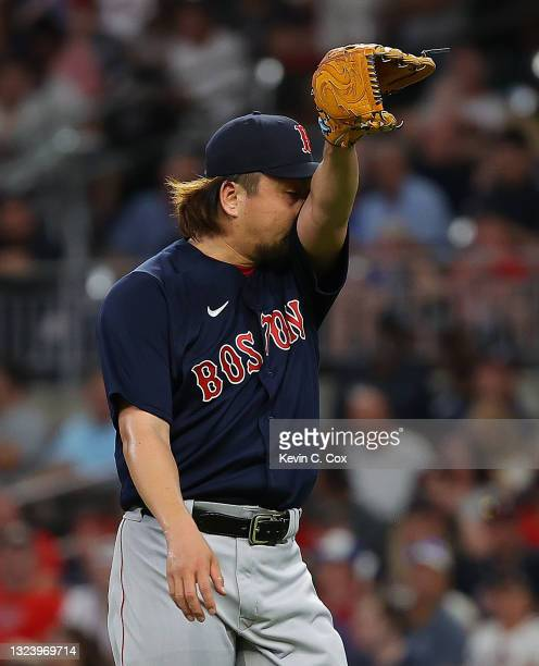 Hirokazu Sawamura of the Boston Red Sox reacts after being pulled in the sixth inning against the Atlanta Braves at Truist Park on June 16, 2021 in...