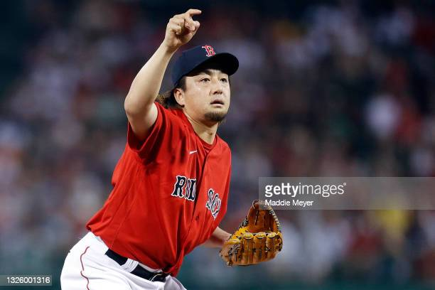 Hirokazu Sawamura of the Boston Red Sox reacts after throwing a pitch during the seventh inning against the Kansas City Royals at Fenway Park on June...