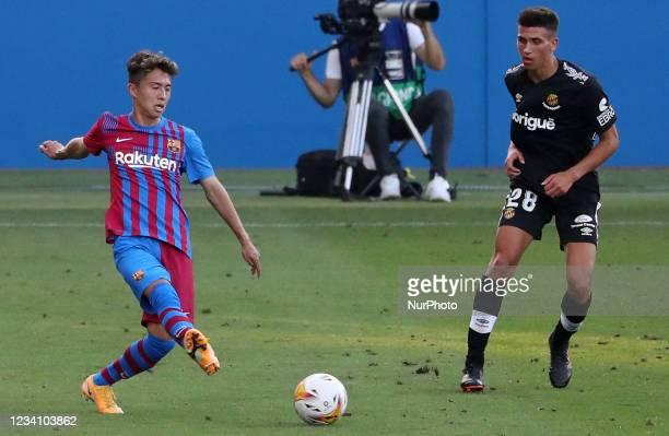 Hiroki Abe and Caro during the friendly match between FC Barcelona and Club Gimnastic de Tarragona, played at the Johan Cruyff Stadium on 21th July...